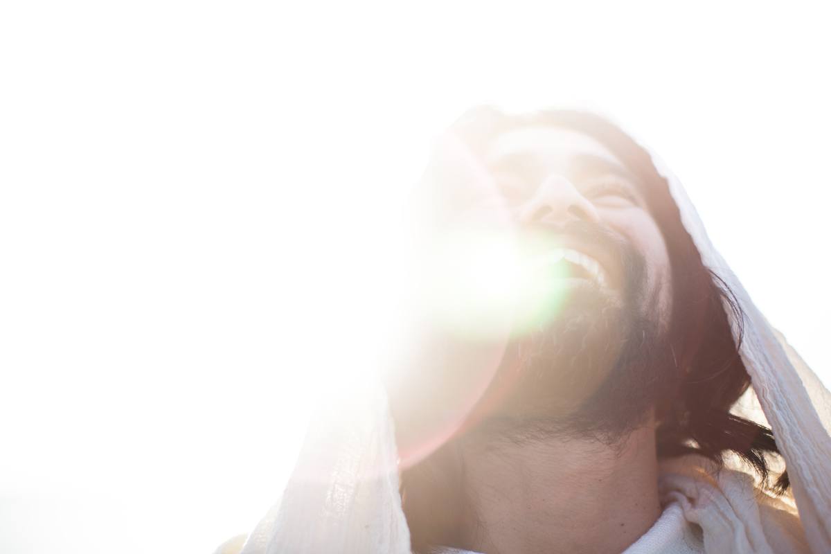 Jesus joyfully smiling in bright white light